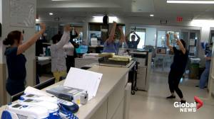 Dancing provides brief respite for front-line healthcare workers dealing with COVID-19 pandemic (02:44)