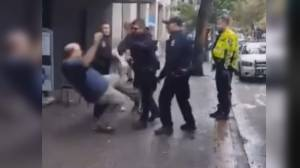 Video shows VPD officer shoving man to the ground (01:47)