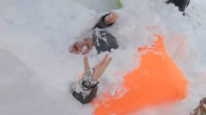 Good Samaritans rush to dig out snowboarders buried in avalanche