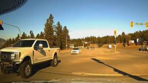 Highway 97 near-miss caught on camera; truck uses turning lanes to pass (00:24)