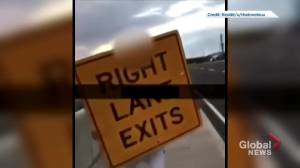 Halton police investigate video appearing to show man throwing traffic sign onto QEW (02:05)