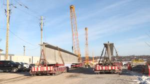 Massive support beams arrive in Kingston as city's third crossing continues to take shape. (02:01)