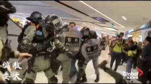 Riot police use pepper spray in Hong Kong shopping mall during Christmas Day protests