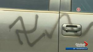 Racist graffiti spray-painted on vehicles, windows smashed in southwest Edmonton