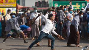Myanmar coup: Supporters of military, opponents clash as protests continue (03:11)