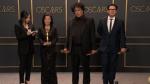 'Parasite' Creators Celebrate Their Historic Oscar Wins Backstage