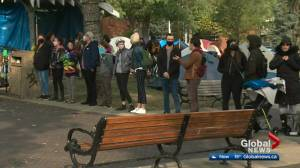 Old Strathcona encampment supporters form barrier around park as deadline to clear out passes