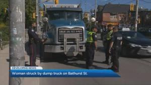 Dump truck hits pedestrian getting out of streetcar on Bathurst Street