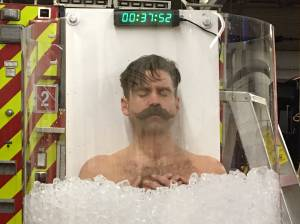 Edmonton firefighter spends an hour in ice to raise money for muscular dystrophy