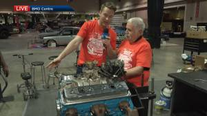 Matthew Conrod changes spark plugs at World of Wheels