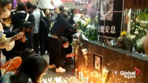 Makeshift memorial erected in Hong Kong for student activist who died from fall