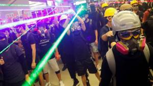 Hong Kong riot police clash with masked protesters at Yuen Long station