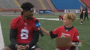 Junior reporter Alex interviews Stamps defensive back DaShaun Amos