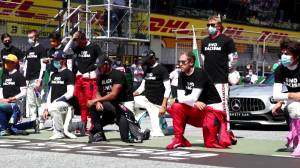 Formula 1 champion Lewis Hamilton, several drivers take a knee