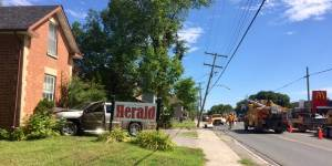 Truck crashes into hydro pole, Lakefield Herald office