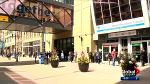 Wait times vary as Calgary COVID-19 vaccination site opens at Telus Convention Centre (02:06)