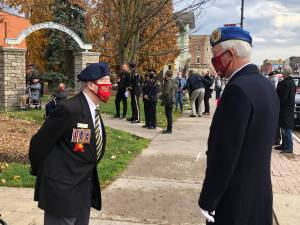 Dozens turn out for smaller Remembrance Day ceremony in Lindsay (01:44)