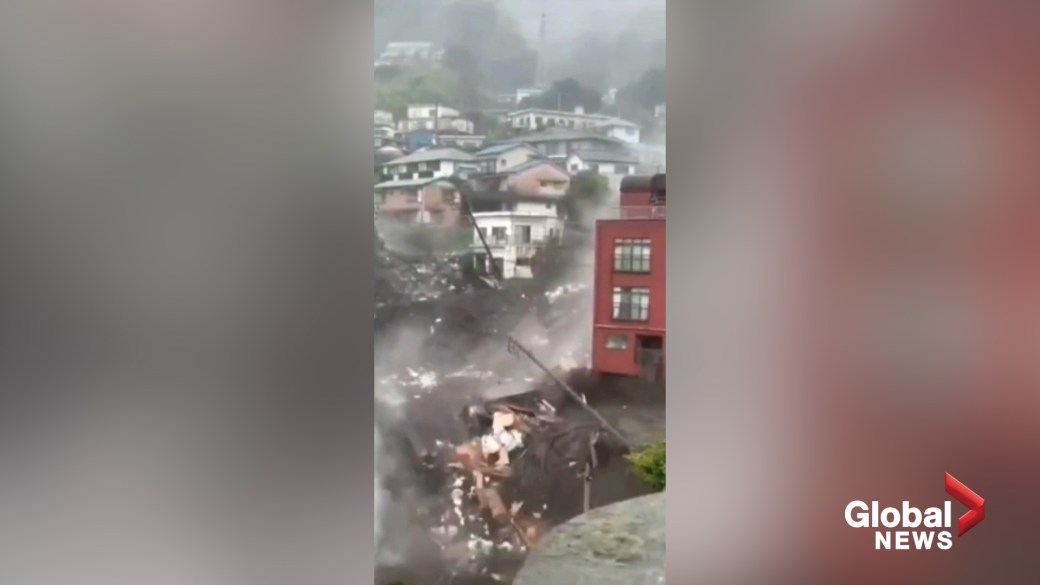 Click to play video: 'Wall of mud slams into row of houses in Japanese town, at least 19 missing'