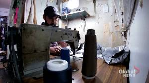 Coronavirus outbreak: Syrian tailor switches from ball gowns to medical ones (00:45)