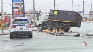 Female pedestrian in life-threatening condition after being struck by truck in Toronto