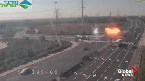 Traffic camera captures moment of rocket impact