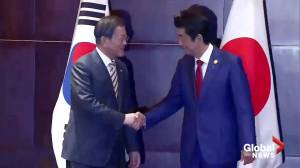 Japan's Abe and South Korea's Moon pledge to mend ties