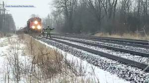 Tyendinaga protesters stand on tracks attempting to block oncoming CN freight train