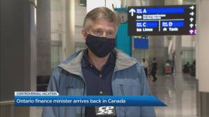 Ontario finance minister arrives back in Canada (02:24)