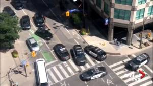 Police investigating car crash, daylight shooting incident in downtown Toronto