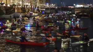 Decorated kayaks light up Copenhagen canal for Saint Lucia's Day
