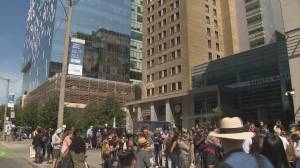 COVID-19: Anti-vaccine protesters gather outside Toronto General Hospital (02:25)