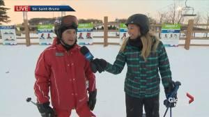 Kim Sullivan takes a ski lesson