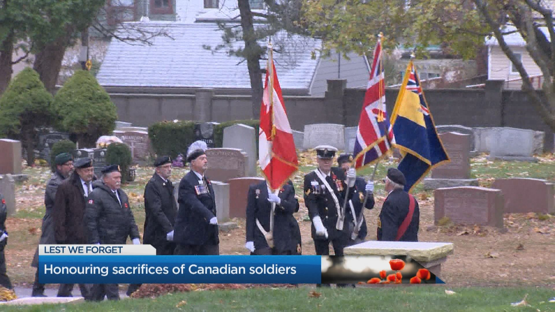 Early sunrise Remembrance Day ceremony outside Sunnybrook Hospital in Toronto