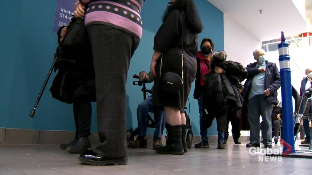 Click to play video 'Long line-ups as mass vaccination begin'