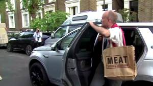 Embattled Boris Johnson aid Dominic Cummings heckled outside his London home