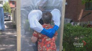 Coronavirus: Montreal man builds hugging station to hold his parents