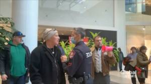 Coronavirus: Calgary police officer criticized after video shows him shaking hands with anti-mask protester at mall (00:46)