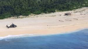 'SOS' written in sand saves 3 stranded men on remote Pacific island