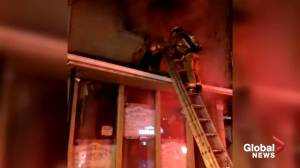 Video appears to show man being rescued from west-end Toronto fire