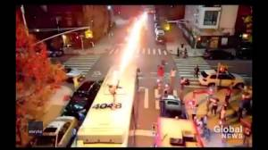 New York rapper turns himself in after shooting flamethrower from atop moving public bus (00:30)