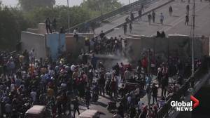 Iraqi protesters break through barricade on bridge to Green Zone