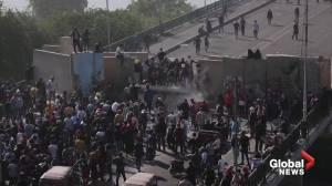 Iraqi protesters break through barricade on bridge to Green Zone