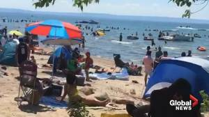 Crowds breaking physical distancing rules at Wasaga Beach on Canada Day