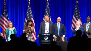 Cory Booker jokingly calls himself 'Dwayne Johnson' after mistakenly introduced as Sen. Michael Bennett