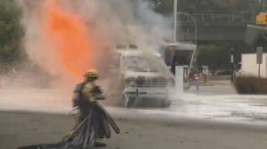 Dramatic video shows Burnaby firefighters battling camper van fire at propane station (01:20)