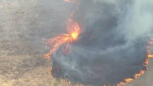 'Firenado' threatens properties in Australia as firefighters tackle nearly 100 blazes