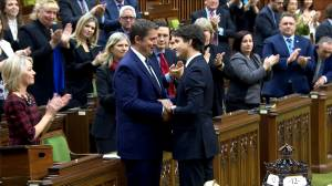 MPs of all parties shake hands with Andrew Scheer in House of Commons