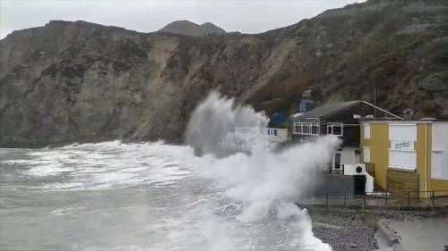 Waves batter coast as Storm Dennis hits U.K. and Ireland | Watch News Videos Online