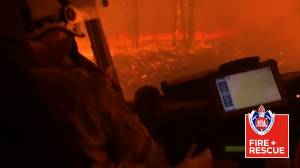 Australian fire crew forced to take shelter in their truck as bushfire rages in Nowra
