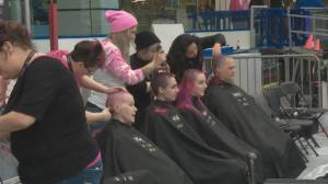Pink hair flying at WEM in support of sick kids in Alberta